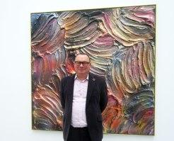 Paul Kasmin in front of one of Jules Olitski's Mitt Paintings